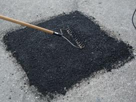 Filling a Pothole with Asphalt